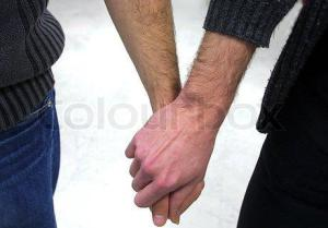 559244-561921-homosexuals-holding-hands-together