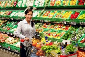 8007504-young-woman-buys-in-the-supermarket-food-and-fruit