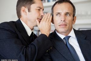 businessmen-whisping-secret-into-ear